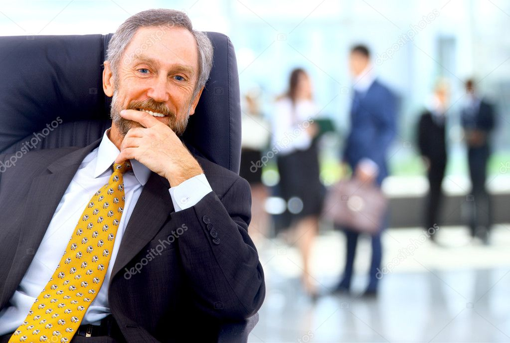 depositphotos_12375181-stock-photo-successful-business-man-standing-with